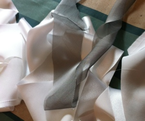 White silk bias tape and polyester chiffon bias tape. A match made in hell.
