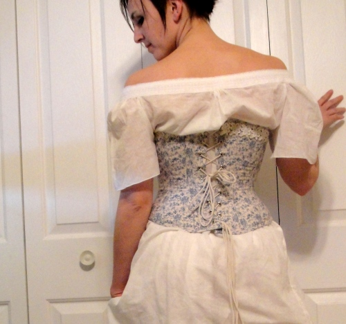 Corset back. Lace job by the fourteen-year-old.